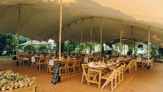Wedding stretch tent hire east yorkshire stretch marquee canopy tent attached to trees wedding hire marquee alternative streaight tables canopy tent to maintain view