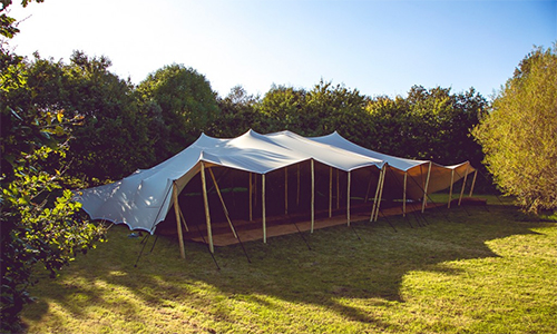 Stretch tent hire wooden poles yorkshire coconut matting 20x15m wedding stretch tent seating 160-180 people on straight tables stretch tent hire at northern prices
