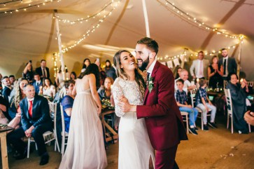 Stretch marquee hire Nottinghamshire happy first dance in stretch tent natural coconut matting peeled wooden poles garden wedding tent hire