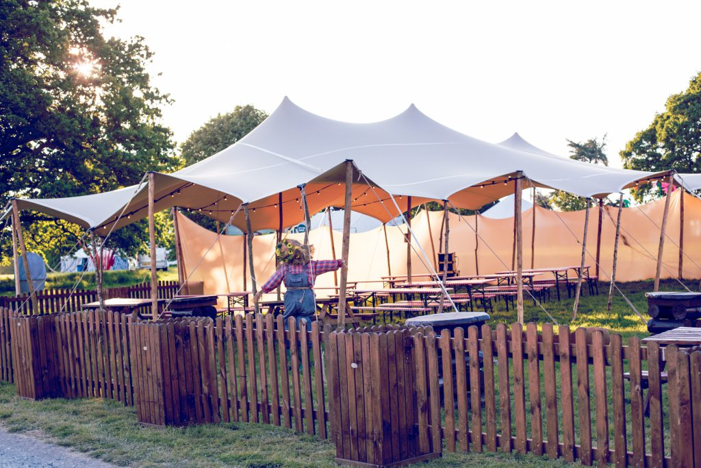 Stretch tent for bar cover with picnic benchs stretch marquee canopy tent 3 king poles wooden poles