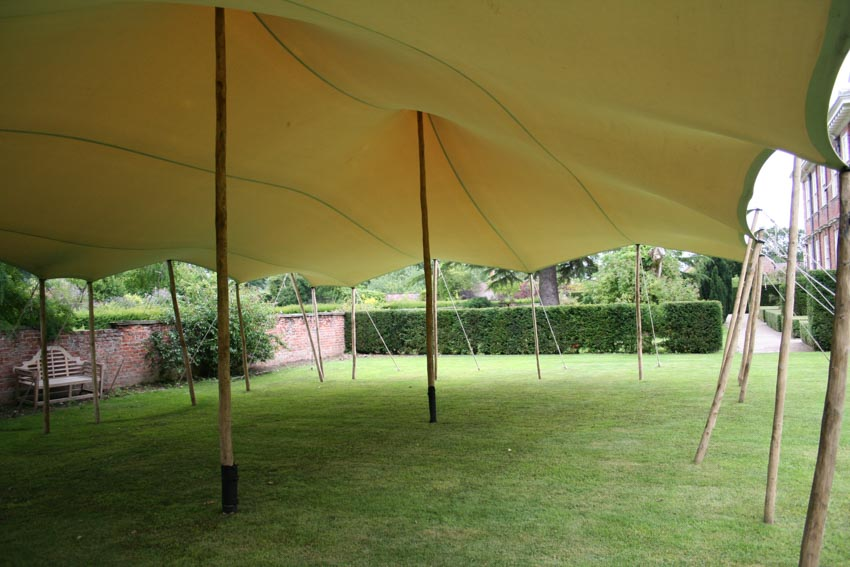 Canopy stretch tent rental off centre king poles to allow an aisle for the ceremony