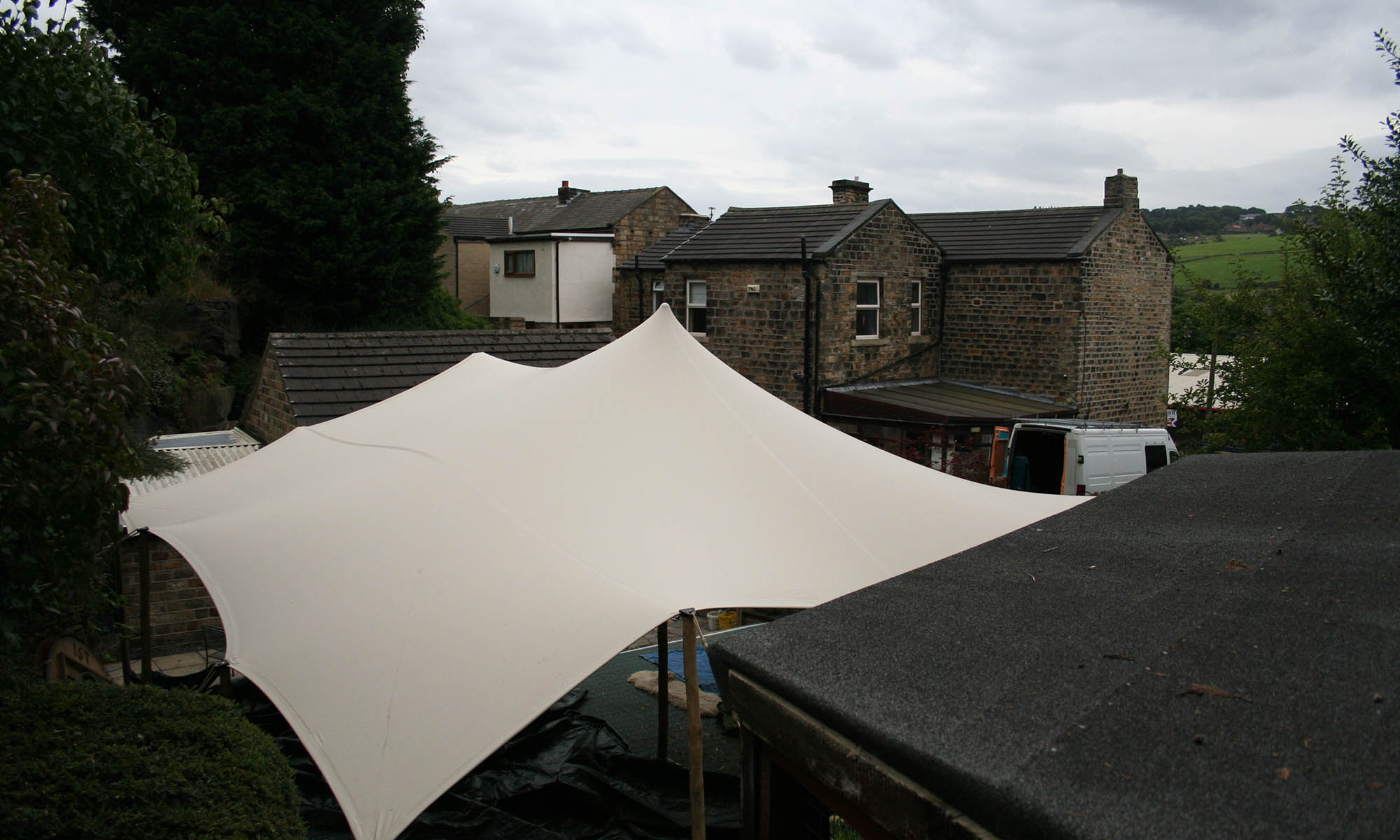 stretch tent hire mirfield west yorkshire united kingdom stretch tent hire awkward stretch tent hire multi level garden cover stretch tent attached to garage over multi level garden stretch tent in awquard garden space attached to walls
