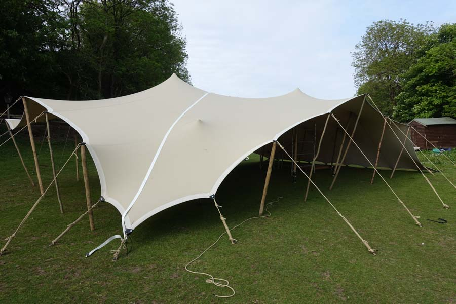 stretch tent dance tent one corner down maximises shelter and standing space