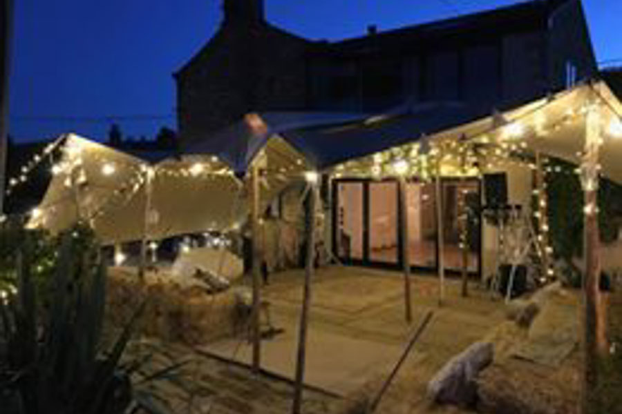 stretch tent rigged straight over patio and a drystone wall. Stretch tent over awkward garden patio and walls.